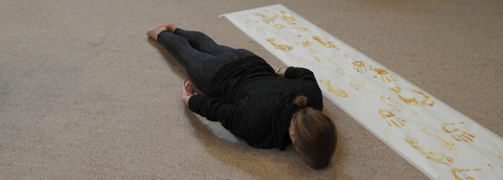 Worship dancer lying face down on the ground getting closer to God.