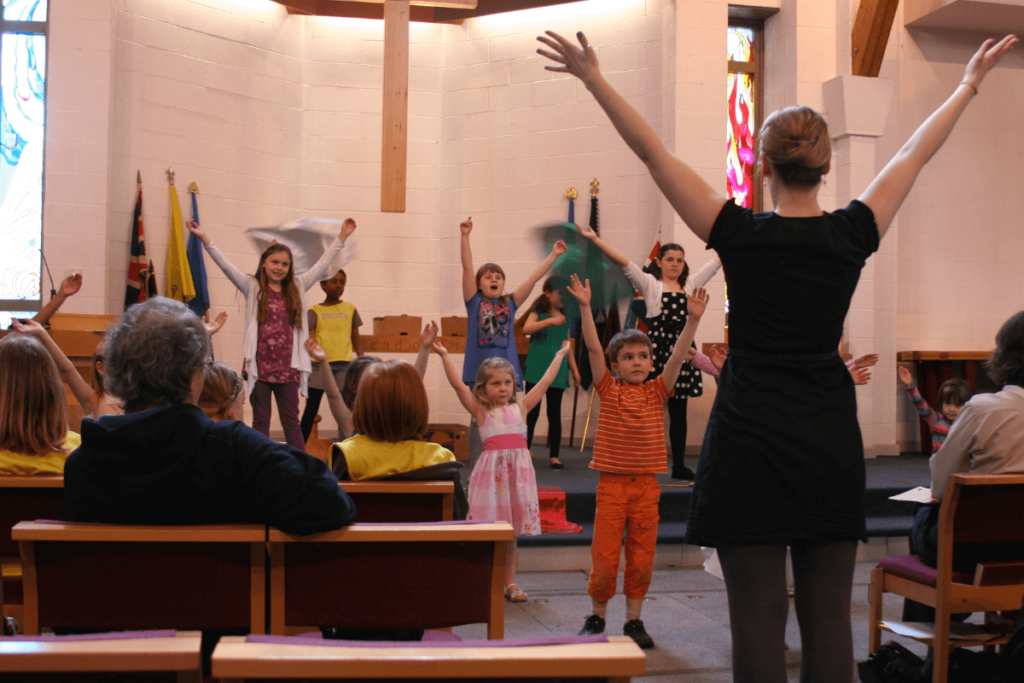 Dancing with children during a kids worship dance.